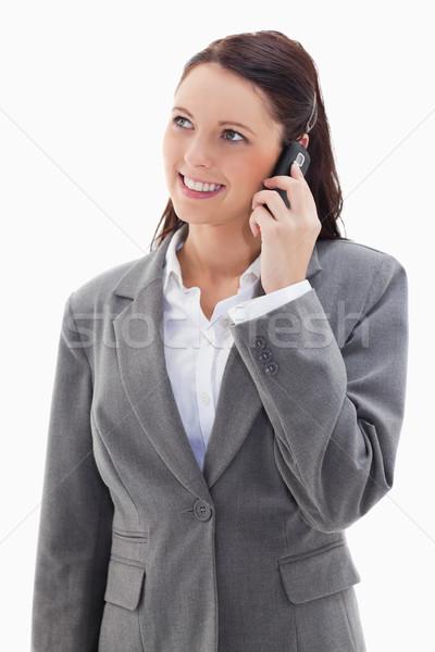 üzletasszony felfelé néz mosolyog telefon fehér arc Stock fotó © wavebreak_media
