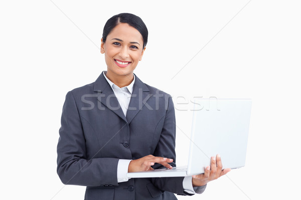 Close up of smiling saleswoman with her notebook against a white background Stock photo © wavebreak_media