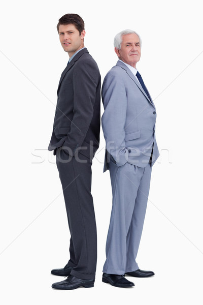 Businessman standing back to back with his mentor against a white background Stock photo © wavebreak_media