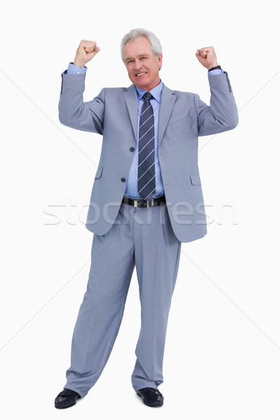 Successful mature tradesman celebrating against a white background Stock photo © wavebreak_media