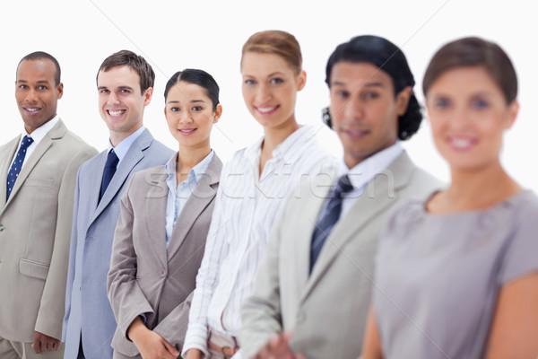 Közelkép üzletemberek mosolyog néz egyenes fókusz Stock fotó © wavebreak_media