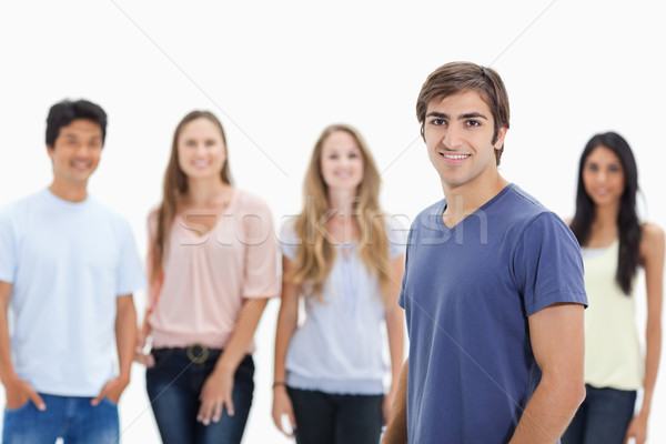People smiling with one in foreground against white background Stock photo © wavebreak_media