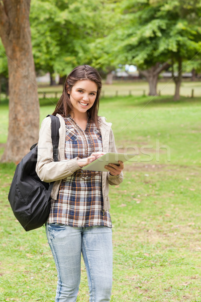 Young student using a touch pad in a park Stock photo © wavebreak_media