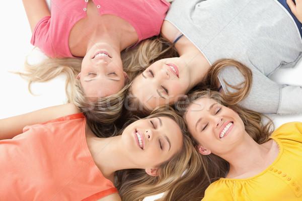 Quatro meninas terreno sorridente menina Foto stock © wavebreak_media