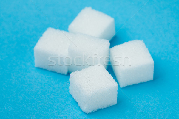 White Sugars against a blue background Stock photo © wavebreak_media