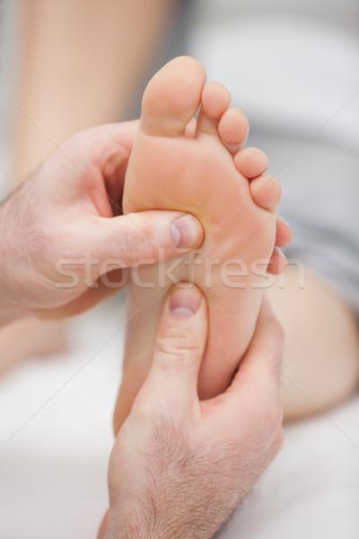 Reflexology massage being made in a room Stock photo © wavebreak_media