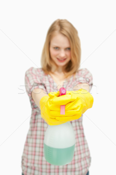 fair-haired woman holding a spray bottle against white background Stock photo © wavebreak_media