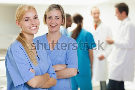 Female nurse looking at camera in hospital hallway Stock photo © wavebreak_media
