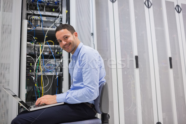 Smiling man working on the servers in data center Stock photo © wavebreak_media