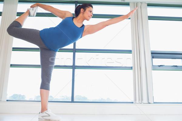 Woman in lord of the dance yoga pose in fitness studio Stock photo © wavebreak_media