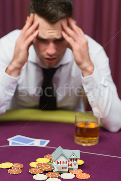 Man betting his house at poker game in casino Stock photo © wavebreak_media