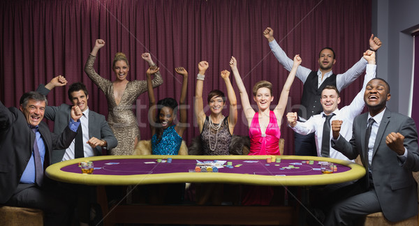Cheering group at poker table in casino Stock photo © wavebreak_media