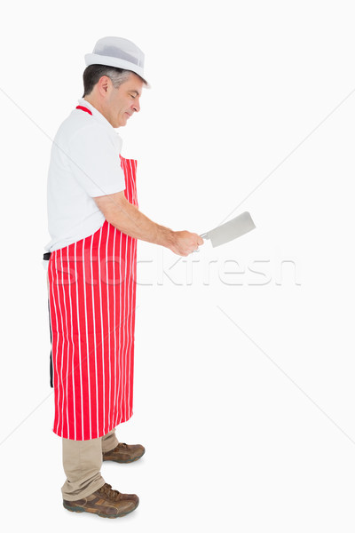 Butcher in apron using meat cleaver Stock photo © wavebreak_media