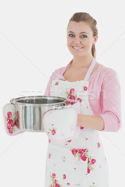 Maid in apron holding kitchen utensil Stock photo © wavebreak_media