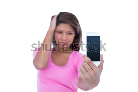 Portrait of casual young woman showing you her new smartphone Stock photo © wavebreak_media