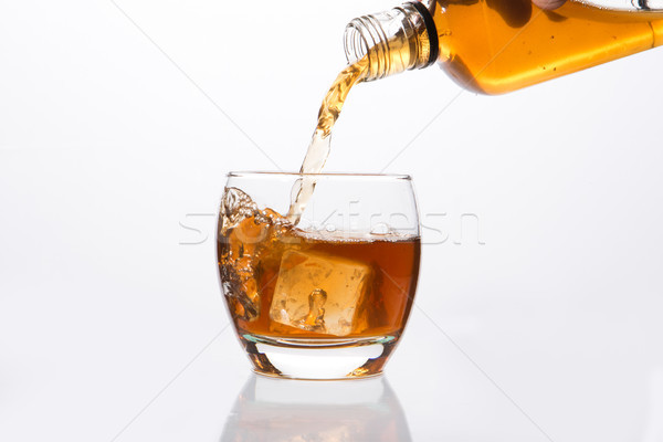 Whisky pouring into glass Stock photo © wavebreak_media
