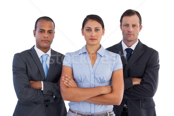 Grupo grave gente de negocios pie junto blanco Foto stock © wavebreak_media