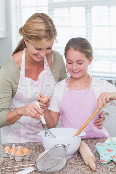 Mother and daughter making cake together  Stock photo © wavebreak_media