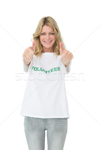 Portrait of a happy female volunteer gesturing thumbs up Stock photo © wavebreak_media