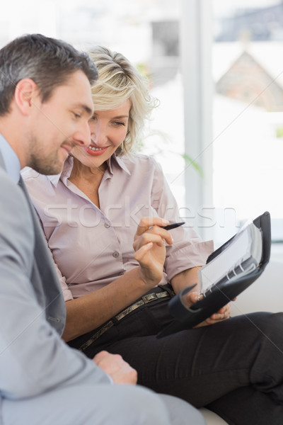Businessman and his secretary with diary at home Stock photo © wavebreak_media