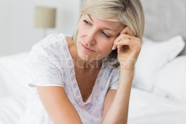 Tensed mature woman sitting in bed Stock photo © wavebreak_media