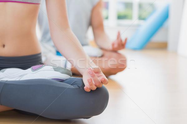Coppia meditazione posa fitness studio Foto d'archivio © wavebreak_media
