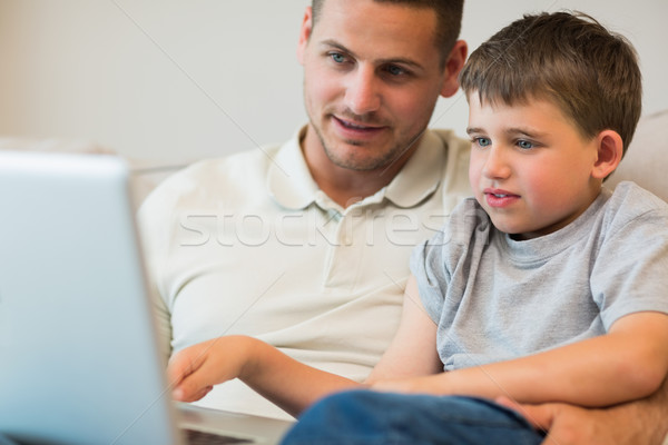 Father assisting boy in using laptop Stock photo © wavebreak_media