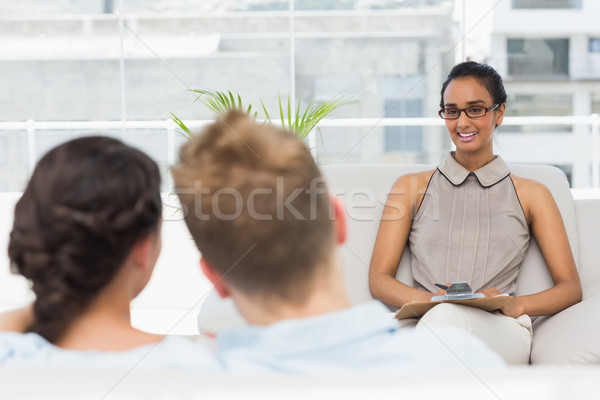Therapist smiling at couple on the couch Stock photo © wavebreak_media