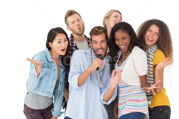 Szczęśliwy grupy znajomych karaoke biały Zdjęcia stock © wavebreak_media