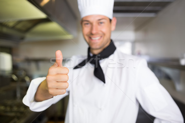Portrait of a smiling male cook gesturing thumbs up Stock photo © wavebreak_media