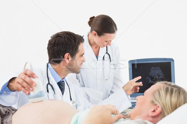 Derűs terhes szőke nő ultrahang scan kórház Stock fotó © wavebreak_media