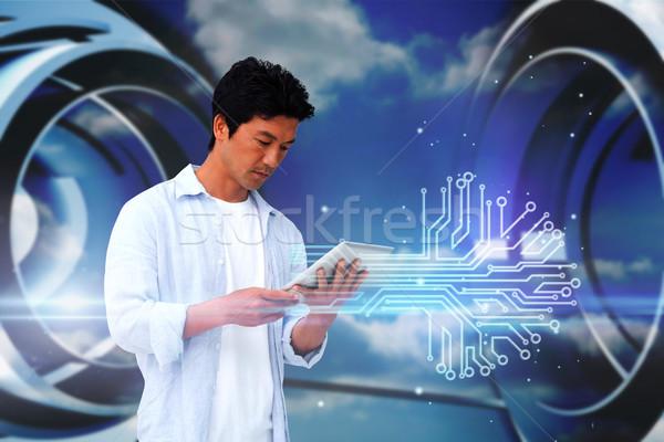 Lezser férfi tabletta nyáklap digitális kompozit kék Stock fotó © wavebreak_media