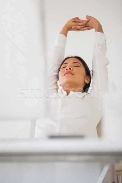Casual businesswoman napping at her desk Stock photo © wavebreak_media