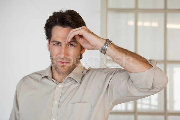 Casual businessman thinking and frowning Stock photo © wavebreak_media