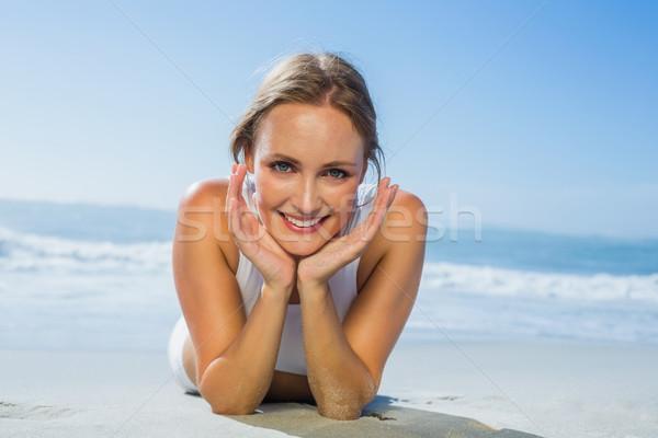 Fit smiling woman lying on the beach Stock photo © wavebreak_media