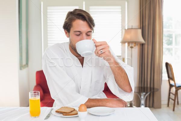 красивый мужчина завтрак халат питьевой кофе домой Сток-фото © wavebreak_media
