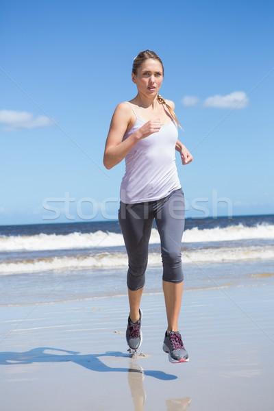 Gericht geschikt blond jogging strand Stockfoto © wavebreak_media