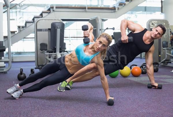 Testépítés férfi nő tart súlyzók palánk Stock fotó © wavebreak_media