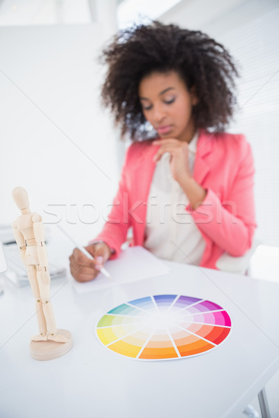 Casual graphic designer working at her desk sketching  Stock photo © wavebreak_media