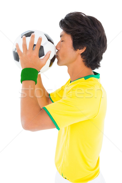 Futbolista amarillo besar pelota blanco hombre Foto stock © wavebreak_media