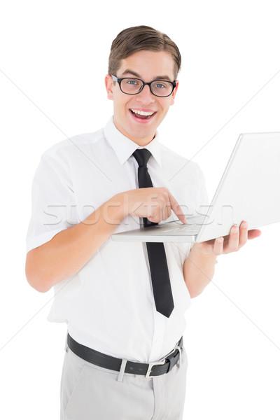 Stock photo: Nerdy businessman holding his laptop