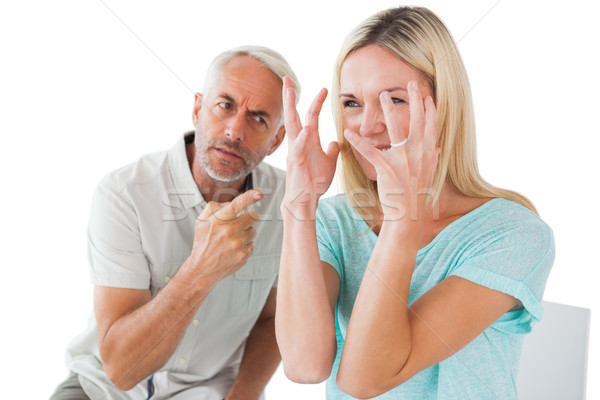 Unhappy couple sitting on chairs having an argument Stock photo © wavebreak_media