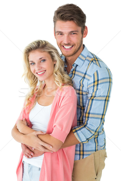 Attractive young couple smiling at camera Stock photo © wavebreak_media