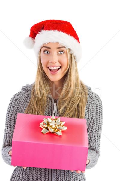 Festive blonde holding christmas gift Stock photo © wavebreak_media