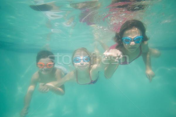 Cute kids posing underwater in pool Stock photo © wavebreak_media