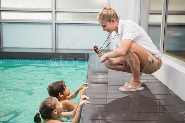 Bastante natación entrenador sonriendo cámara ocio Foto stock © wavebreak_media