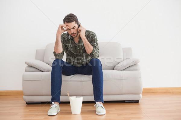 Zavart férfi néz kínai étel padló otthon Stock fotó © wavebreak_media