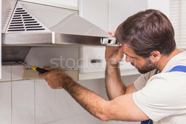 Manitas horno cocina hombre de trabajo Foto stock © wavebreak_media
