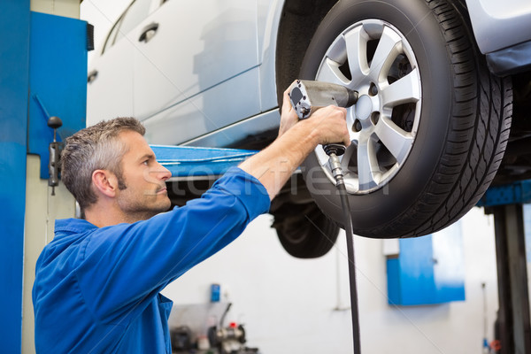 Mechanic adjusting the tire wheel Stock photo © wavebreak_media
