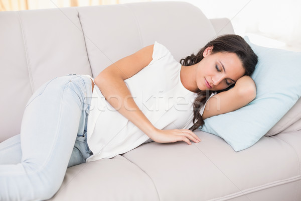 Pretty brunette napping on couch Stock photo © wavebreak_media